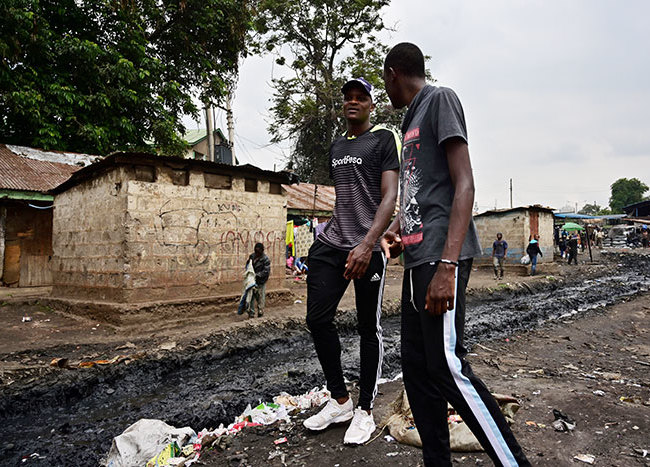 arrison sotsi  with younger brother li stroll through ramshackle uthurwa estate in airobi on une 13 2019  oth are cousins of nglish remier eague lub otenham otspurs midfielder ictor anyama who grew up in this place honing his football skills among the rows of singleroom units to become a local icon for the game aspirants and enthusiasts hoto by