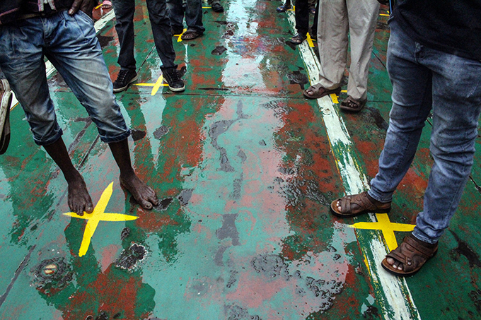 ommuters stand on yellow marks that indicates the physical distancing to curb the 19 coronavirus from spreading on a ferry at ikoni ferry terminal in ombasa
