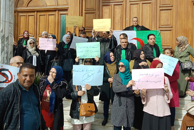 lgerian judges held placards as they protested against their ailing presidents bid for a fifth term in power