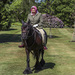 Queen Elizabeth, 94, rides out on Fell pony