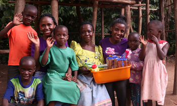 1beatrice nabawanuka with her children and some of the items donated to her a 350x210