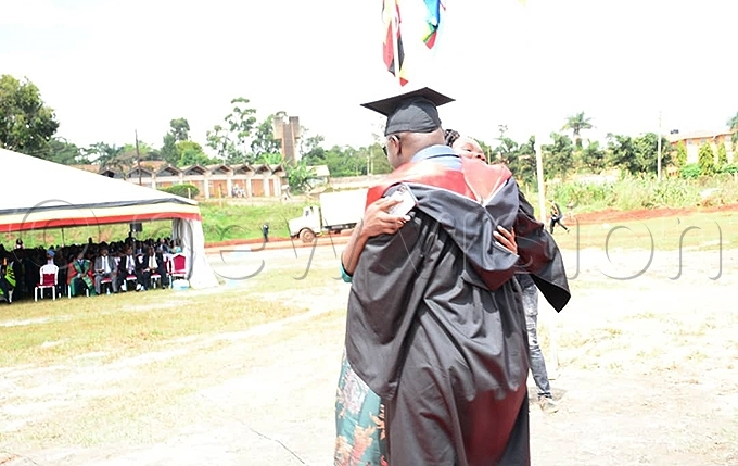 he couple hugs during the ceremony hoto by imothy urungi