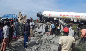 People pulling bodies of the deceased from the wrackage of fuso lorry and fuel tanker 350x210