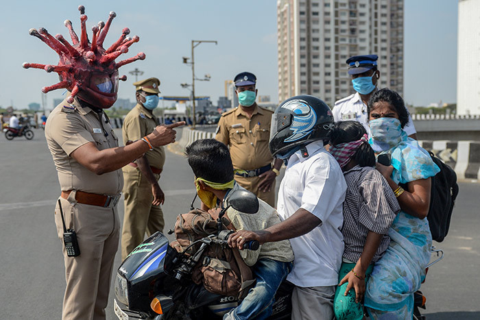 olice inspector ajesh abu  wearing coronavirusthemed helmet speaks to a family on a motorbike at a checkpoint during a governmentimposed nationwide lockdown as a preventive measure against the 19 coronavirus in hennai on arch 28 2020  ne minute theyre dancing in the street in comical coronavirus helmets the next theyre seen beating people for flouting a nationwide lockdown  ndian police have played good cop bad cop in a bid to halt the spread of coronavirus he streets of ndias cities have been largely deserted for more than a week of the governments 21day lockdown  no mean feat in a country of 13 billion people famed for their flexible attitude towards authority hoto by run