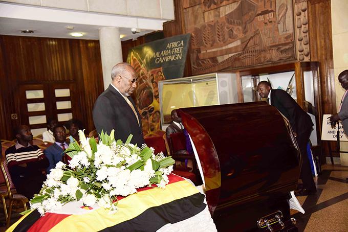rime inister uhakana ugunda pays his respects to the former ttorney eneral hoto by ennedy ryema