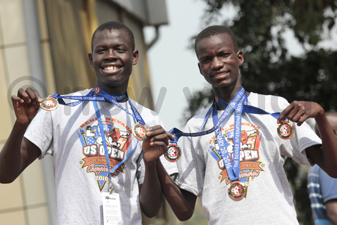 oyson kwera  and cira swaldo show off their medals up on return from the  pen on uesday hoto by amson pus