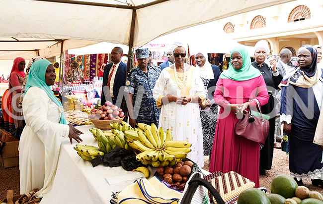 he irst ady anet useveni  ecretary for omen and outh addiyyah amakula third right and eputy nspector eneral of overnment iriam agadya second right tour the stalls where uslim omen exhibited their good at the event
