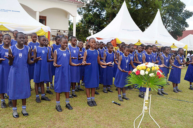 upils of aint atrick irls rimary chool igulu ganga district perform a musical item on other ary evin