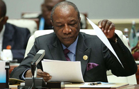 Guinea president's party wins majority in disputed polls