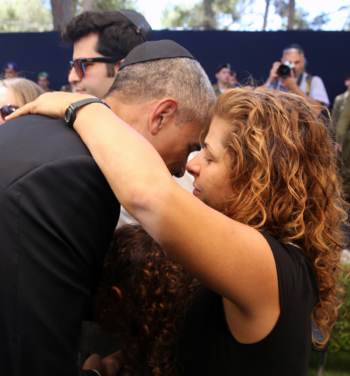 resident arack bama  comforts relatives of former sraeli president and rime inister himon eres following his funeral at the ount erzl national cemetery in erusalem on eptember 30 2016 ool and  photo  menahem kahana