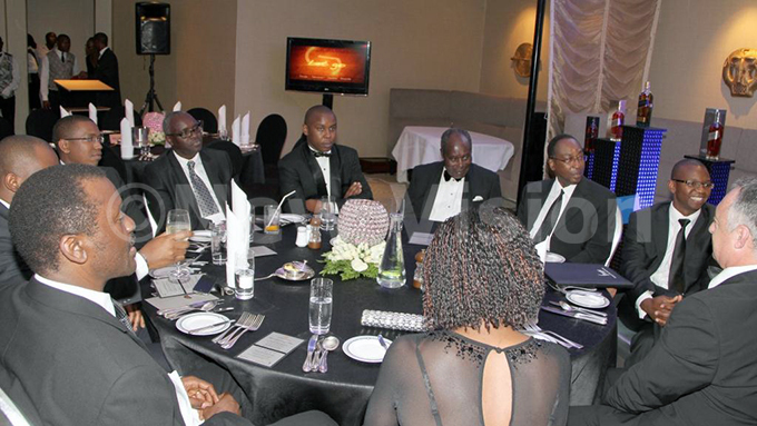 harlie ubega abrice ulinda obert abushenga rartin liker and r lan honubi at a dinner