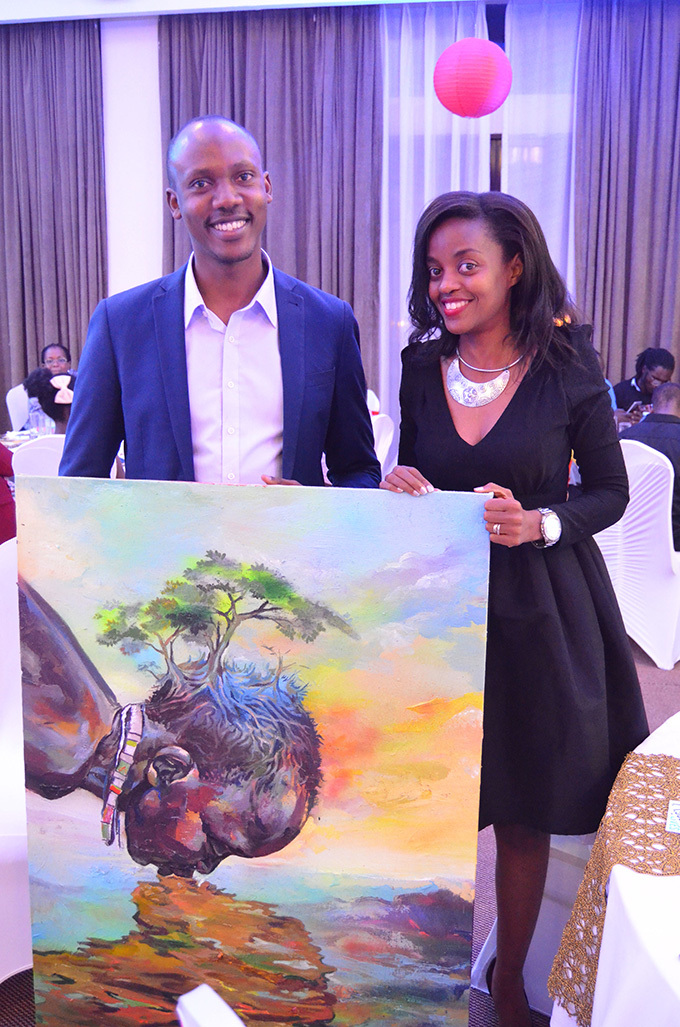 r teven and aphine ugabe with the art piece they bought at sh10m