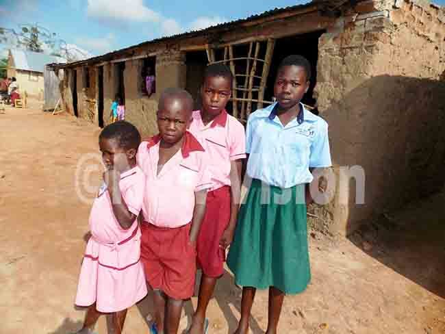kwiis four children at liedi rimary chool hoto by mmanuel lomu