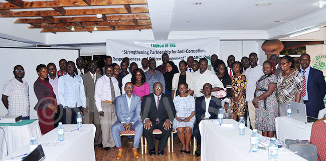 he anticorruption activists posing for a picture with the deputy  eorge amugemereire the function