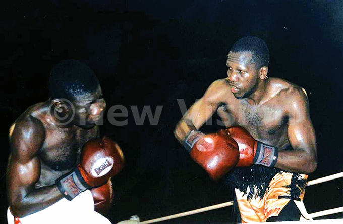 odfrey yakana sizes it out with iendomne atonang during his come back fight at akivubo uly 26 2003