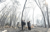 'Sad' Trump visits fire-wracked California, blames mismanagement