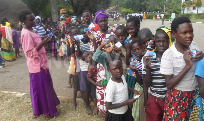 hildren excited with meal cards as they lineup for food y awrence kwakol