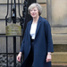 May takes tough Brexit stance as UK holds local elections