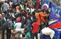 In Pictures: Ugandans head home for Christmas