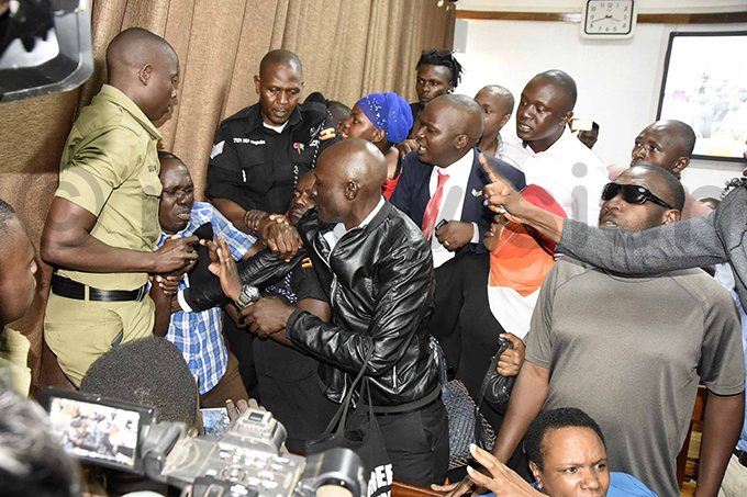 olice clashed with supporters of tella yanzi who threw an empty water bottle at the magistrate as she read the sentence hoto by ennedy ryema