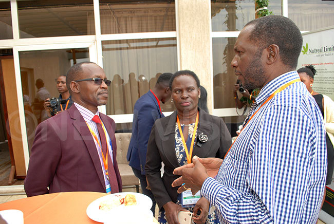 red akwagala hairman of ulago research and ethics committee chatting with r sther abirekere the head of wanamugimu utrition unit ulago ational eferral hospital center and r ackson fitre the lead  investigator of the utriish project