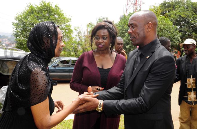 ngella atatumba introduces former minister enry anyenzaki to rincess agaya at ubaga athedral after the requiem mass hoto by ddie sejjoba