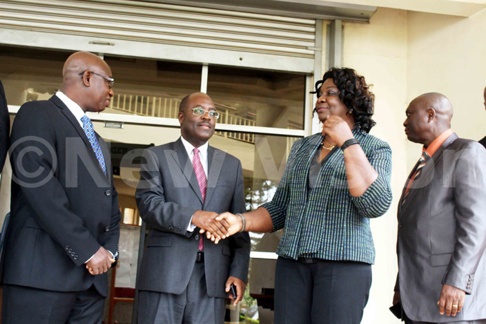 he acting irector eneral ealth ervices nthony bonye shaks hands with adina  ahman ierra eones eputy inister of ealth and anitation  after a conference that hosted a delegation of experts from uinea and ierra eone  at inistry of ealth eadquarters on une 21 2016hoto acheal assuuna