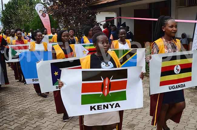 tudents of ganda artyrs niversity kozi carry the flags of their respective countries during the procession for the universitys 24th graduation ceremony