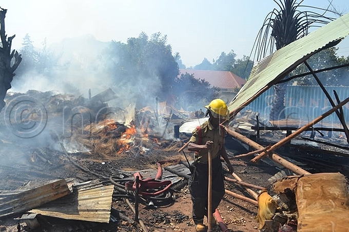 ire rigade personnel were on hand to put out the devastating fire hoto by odfrey sempijja