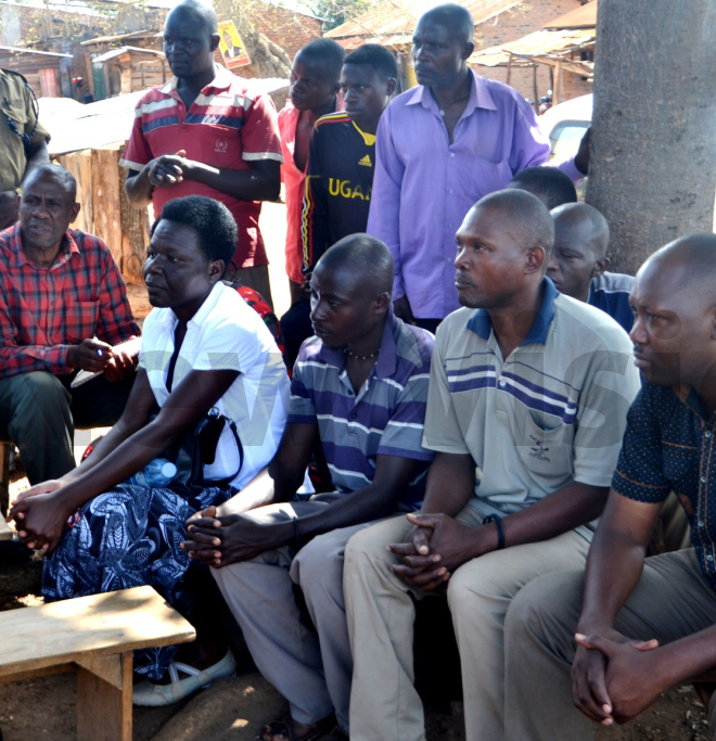 askforce members meet residents in inziiro village