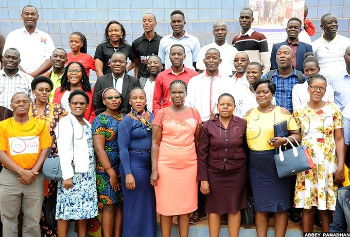 r ianah akiganda second right usan poil umusiime the xecutive irector orum for frican omen ducationalists  third right and other  delegates posing for group picture after the dissemination of the exuality ducation scoping study findings at otel frican on ebruary 13 2020 hoto amadhan bbey