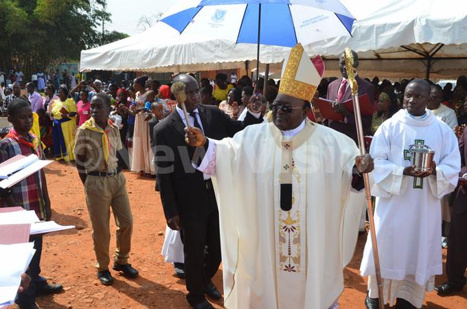 rchbishop wanga blesses hristians during the celebrations at abulagala atholic hurch