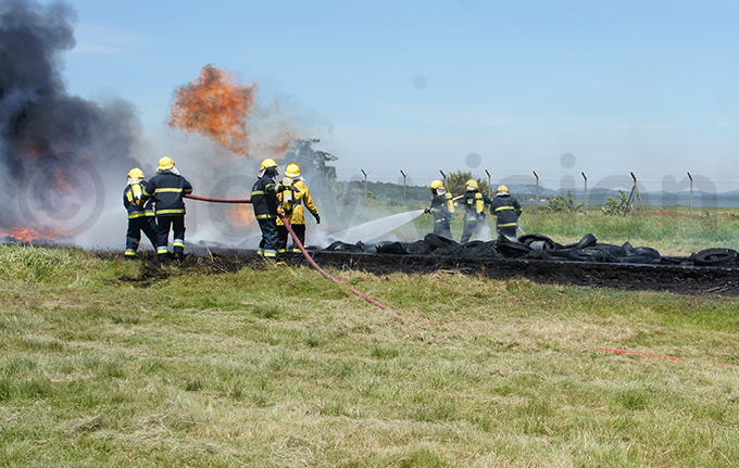 ire fighters putting out a fire during the exercise hoto by ulius uwemba