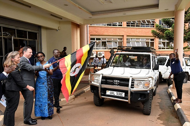 he inister of ealth rane uth ceng third left and  the eputy hief of issionmbassy in ganda hristopher rafft second left flagging off various teams to the communities  during the launch of 2020 ganda opulationbased  mpact ssesment   at the inistry of health head offices in ampala on hursday