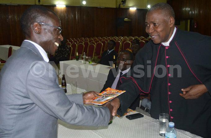 sgr erald alumba hands over a copy of subugas book to awrence subuga