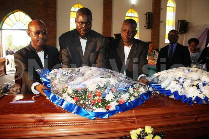 he late uwanguzis siblings lay a wreath on his casket