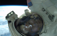 NASA astronaut shares spacewalk selfie