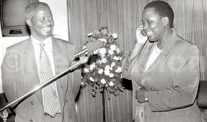 he ice resident r pecioza azibwe talking on a cellular phone with the ritish inister inda halker in ritain during the launching on ay 31st 1995 and left is r assa irigwa