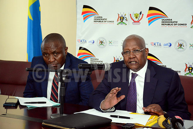 am utesa right minister of foreign affairs speaking at the media launch for the business forum between ganda and  ongo at the ministry of foreign affairs ovember 052019 eft is ules galu alala the charge de affairs of the emocratic epublic of ongo hoto by ddie sejjoba