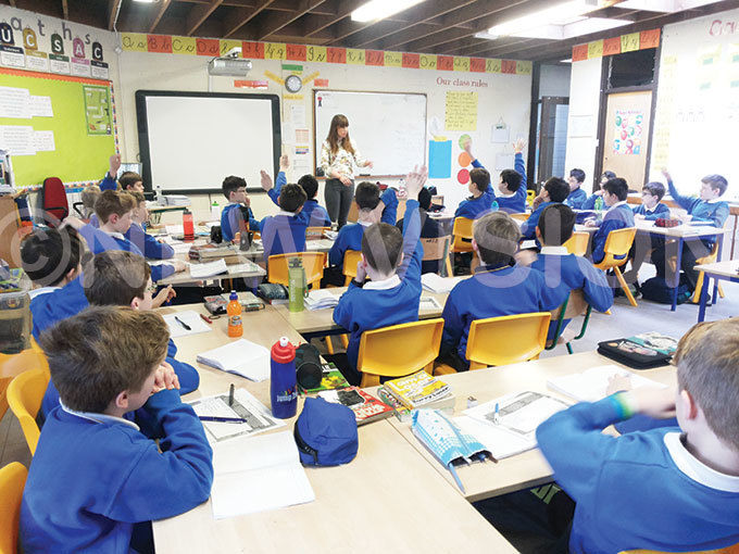 eacher liona ollins of t atricks oys ublin takes the fourth class pupils through a history lesson