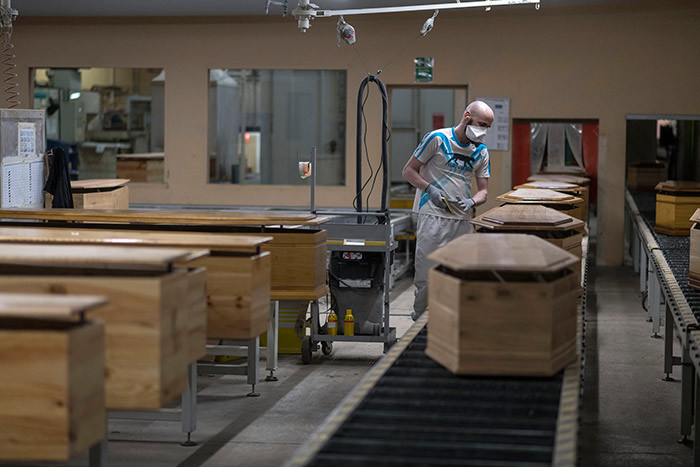 n employee of rances biggest coffinmaker  group controls coffins in ussey eastern rance on pril 8 2020 amid the spread of the 19 the disease caused by the novel coronavirus hoto by