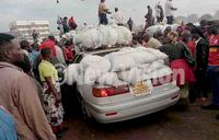 How loaded Nsenene vehicles dodge traffic to access markets