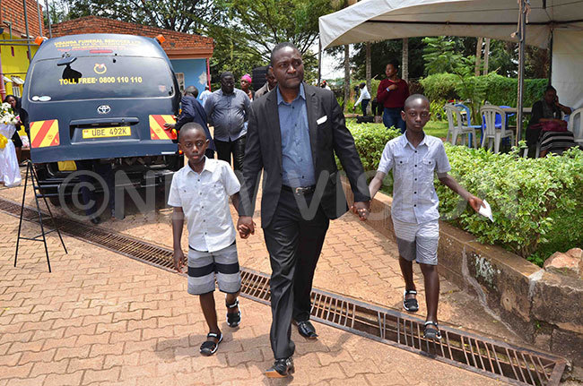 essy itto the husband of the late eborah ercy abukenya walks with his two children