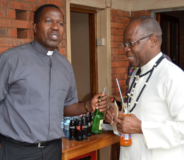 r aul asolo left shares a light moment with r ichard nyombi