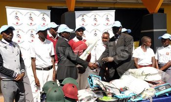 Ncs assistant general secretary timothy katende hands over kits to upcountry school 2 1 350x210