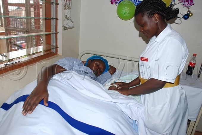 loria iwanuka a midwife attending to a mother who delivered a baby on hristmas ay at ubaga ospital hoto by imon eter umwine
