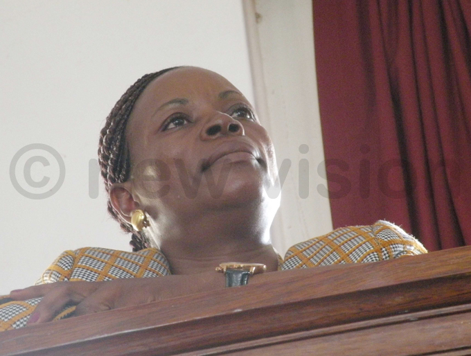 asiwukiras widow  arah abikolo in the dock at the igh ourt in ampala hoto by amadhan bbey