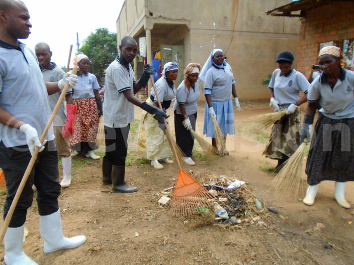 he 2 hairperson of golo alongo lorence alubega  joins the friends and staff of kozi ospital in the cleaning exercise