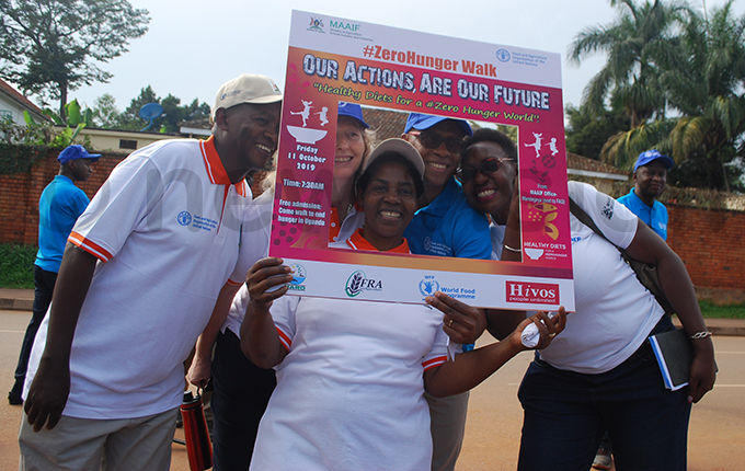 ome of the participants with a placard during the walk that was organised by inistry of griculture nimal ndustry and isheries in commemoration of the orld ood ay hoto by awrence ulondo