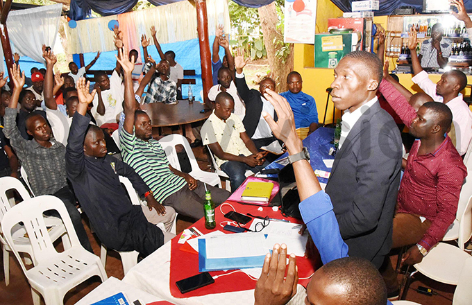 embers of mart nline rivers ssociation voting by show of hands during a meeting at entenary ark in ampala he members unanimously voted to disassociate themselves from existing ridehailing smartphone apps and vowed to create their own hoto by palanyi sentongo